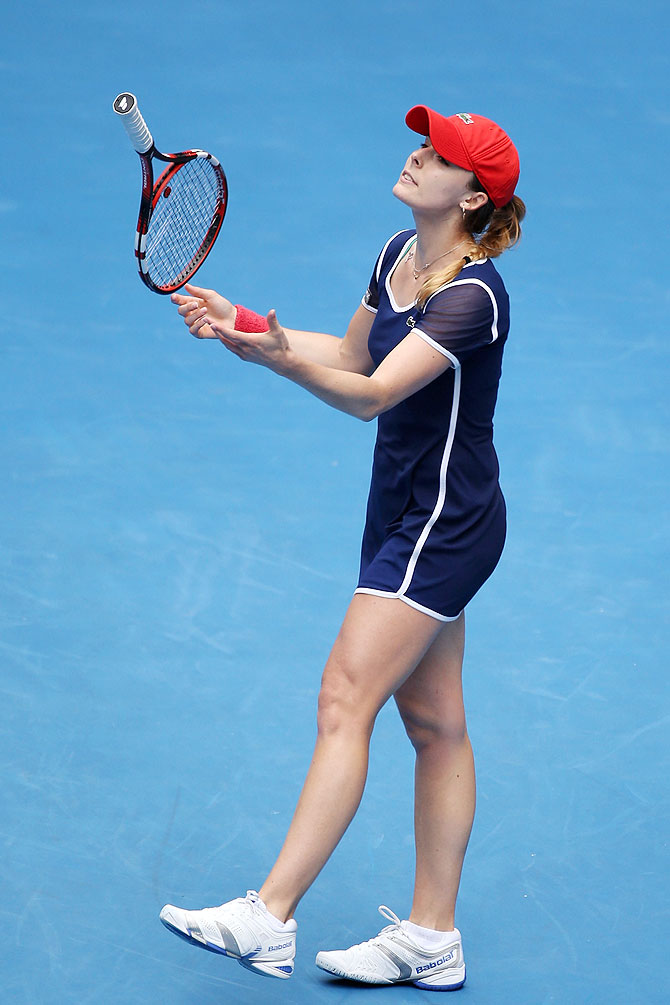 Alize Cornet of France throws her racquet in frustration during her match against Maria Sharapova of Russia at the Australian Open at Melbourne Park on Sunday