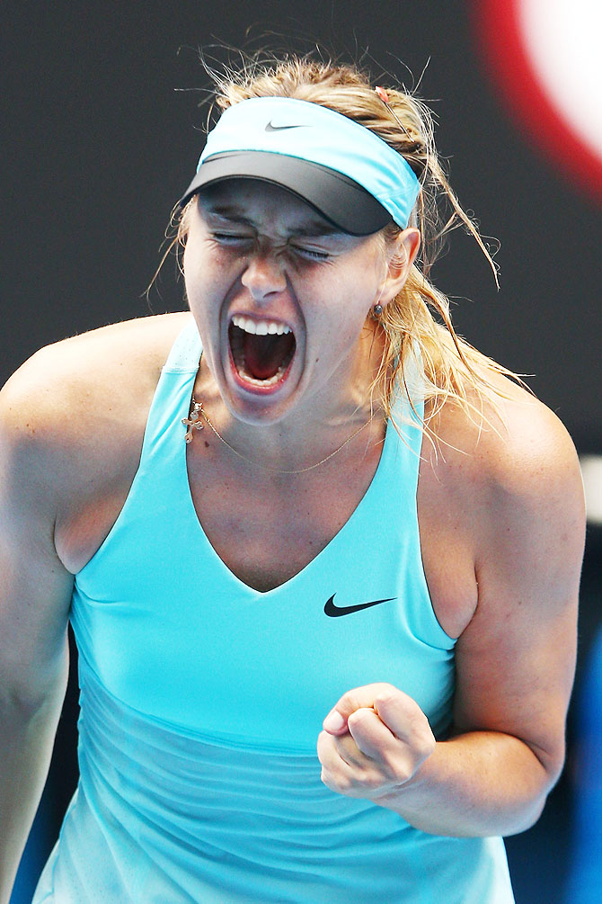 Maria Sharapova of Russia celebrates a point in her third round match against Alize Cornet of France