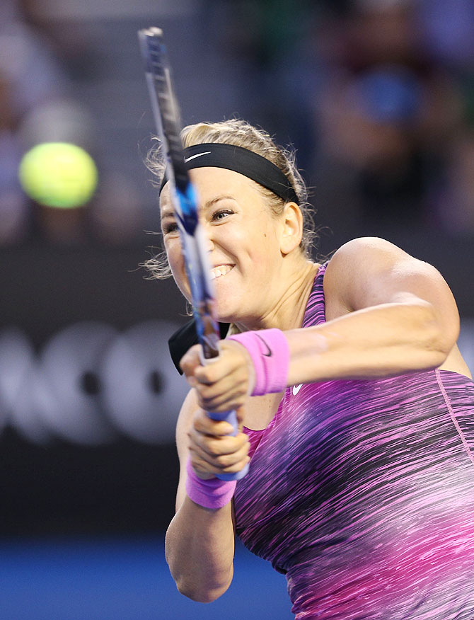Victoria Azarenka of Belarus plays a backhand in her third round match against Yvonne Meusburger of Austria on Saturday