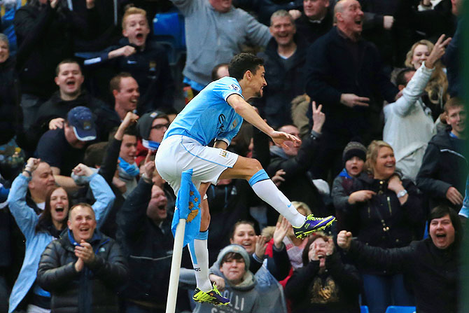 Jesus Navas of Manchester City celebrates after scoring against Cardiff City at the Etihad Stadium in Manchester on Saturday