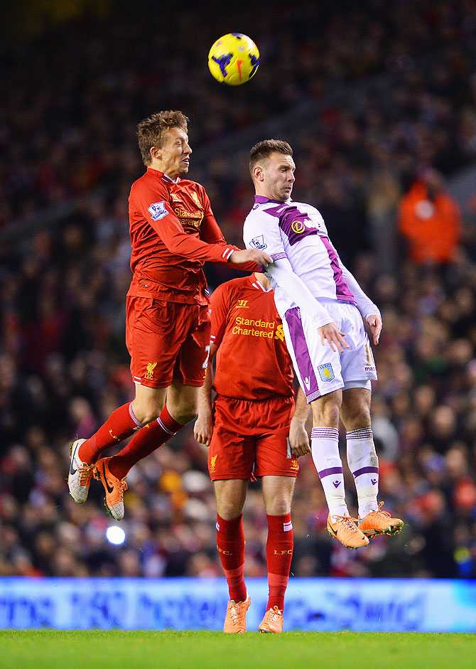 Lucas of Liverpool (left) and Andreas Weimann of Aston Villa vie for possession during their match at Anfield in Liverpool on Sunday