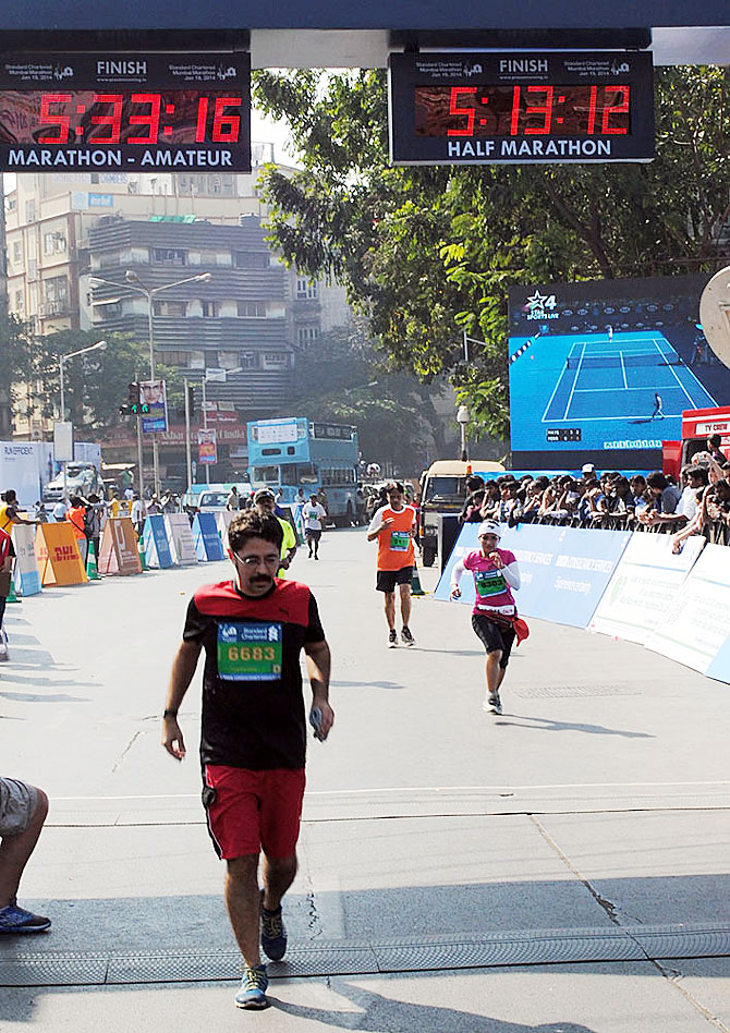 An amateur runner nears the finish line