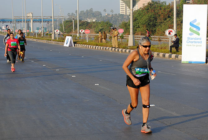 This old lady runs while the younger lot are seen walking during the Marathon on Sunday