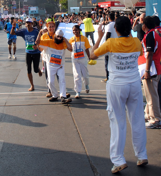 A physically challenged man enjoys his moment at the Mumbai Marathon