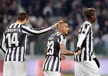 Arturo Vidal of Juventus (centre) celebrates scoring the first goal during the Serie A match between Juventus and UC Sampdoria at Juventus Arena in Turin on Saturday