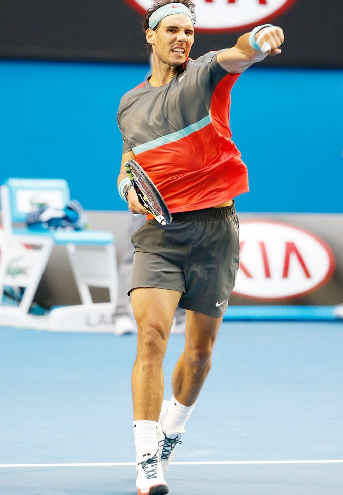 Rafael Nadal of Spain celebrates winning his fourth round match against Kei Nishikori