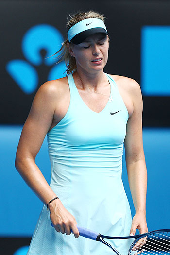 Maria Sharapova of Russia reacts to a point in her fourth round match against Dominika Cibulkova of Slovakia on Monday