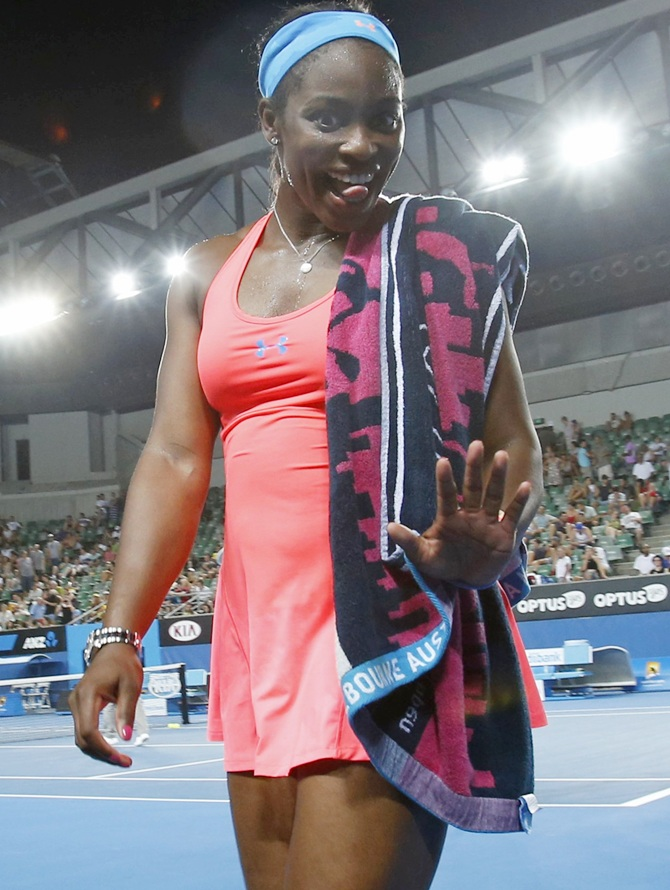 Sloane Stephens of the United States smiles as she leaves the court
