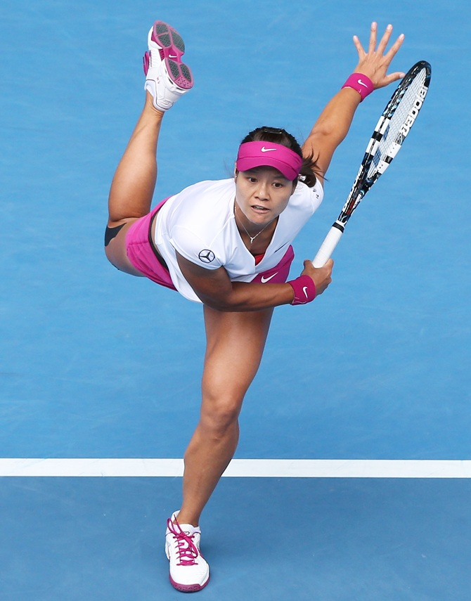 Li Na of China serves in her quarterfinal match against   Flavia Pennetta of Italy