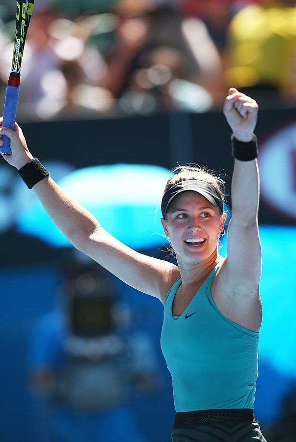 Eugenie Bouchard of Canada celebrates winning her quarterfinal match against Ana Ivanovic of Serbia