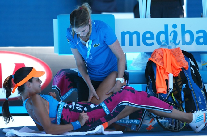 Ana Ivanovic of Serbia receives medical attention
