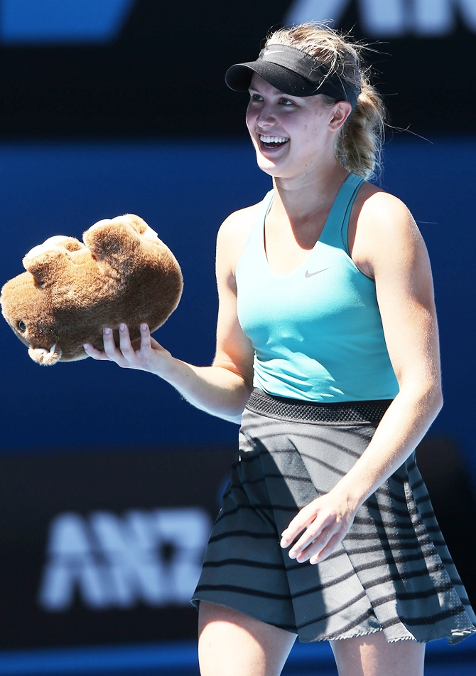 Eugenie Bouchard of Canada holds a toy wombat thrown to her from the crowd after winning her quarterfinal match