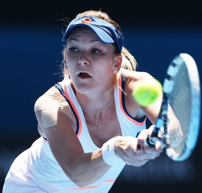 Agnieszka Radwanska of Poland plays a backhand in her quarterfinal match against Victoria Azarenka