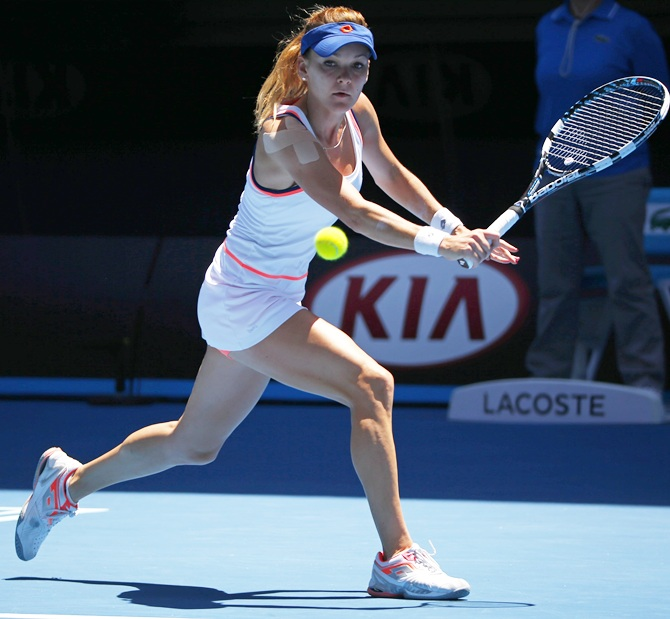 Agnieszka Radwanska of Poland hits a return to Victoria Azarenka