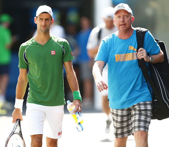 Novak Djokovic of Serbia and his coach Boris Becker