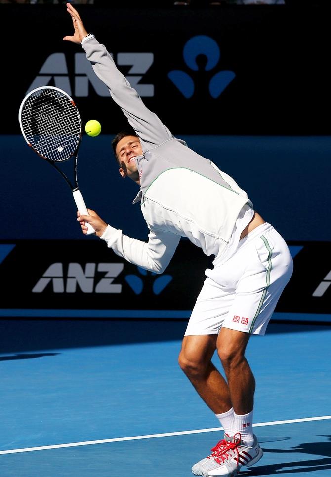 Novak Djokovic of Serbia impersonates his coach Boris Becker on court