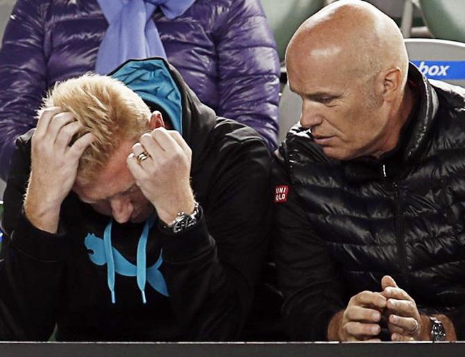 4Boris Becker (left), coach of Novak Djokovic of Serbia look dejected