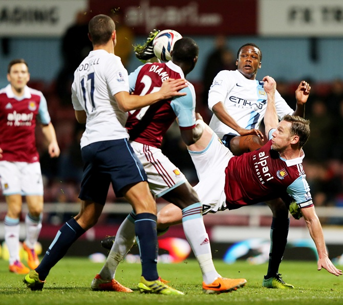 Kevin Nolan of West Ham United attempts an acrobatic shot