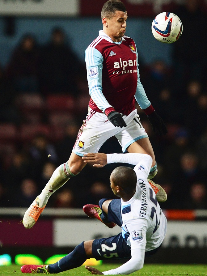 Ravel Morrison of West Ham United battles with Fernandinho of Manchester City