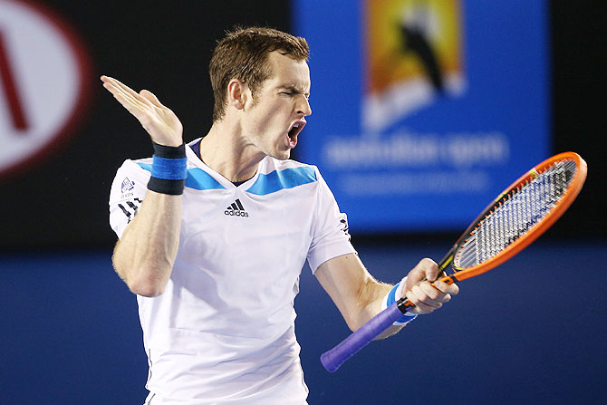 Andy Murray reacts to a point in his quarter-final against Roger Federer