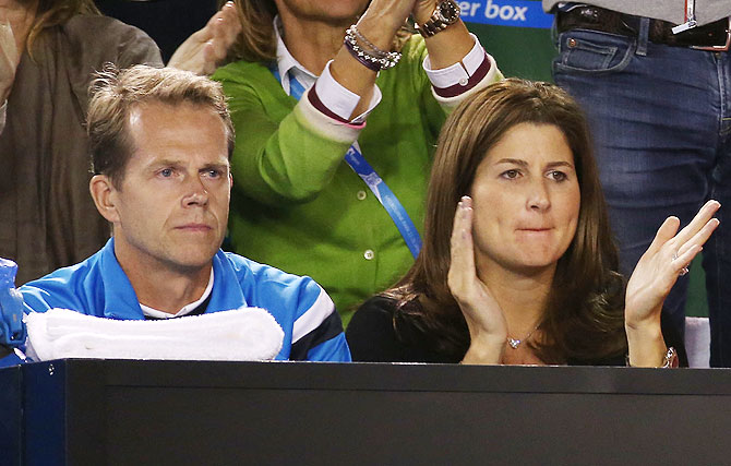 Stefan Edberg, Roger Federer's coach (left) and Mirka Federer, watche the quarter-final between Roger Federer and Andy Murray