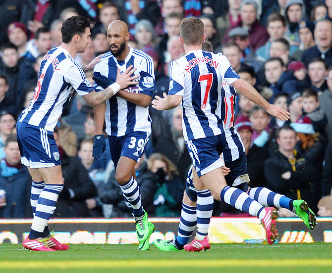 Nicolas Anelka of West Brom (centre) does the 'quenelle' salute' as he celebrates scoring a goal against West Ham United during their English Premier League match on December 28, 2013