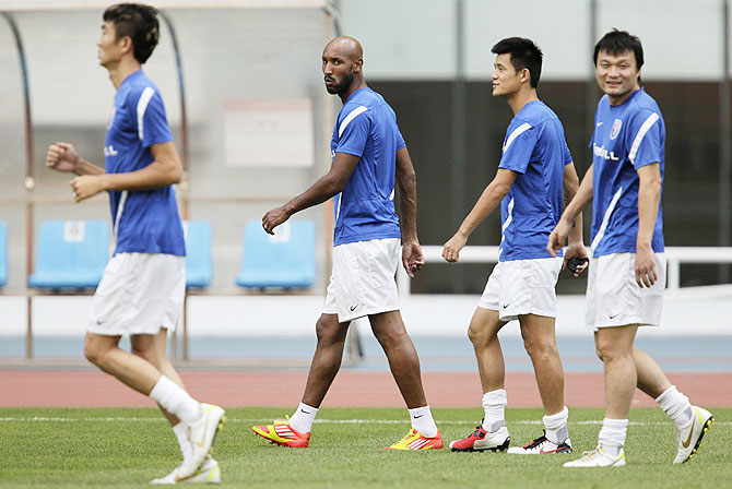 Shanghai Shenhua's Nicolas Anelka of France (2nd from left) during a training session