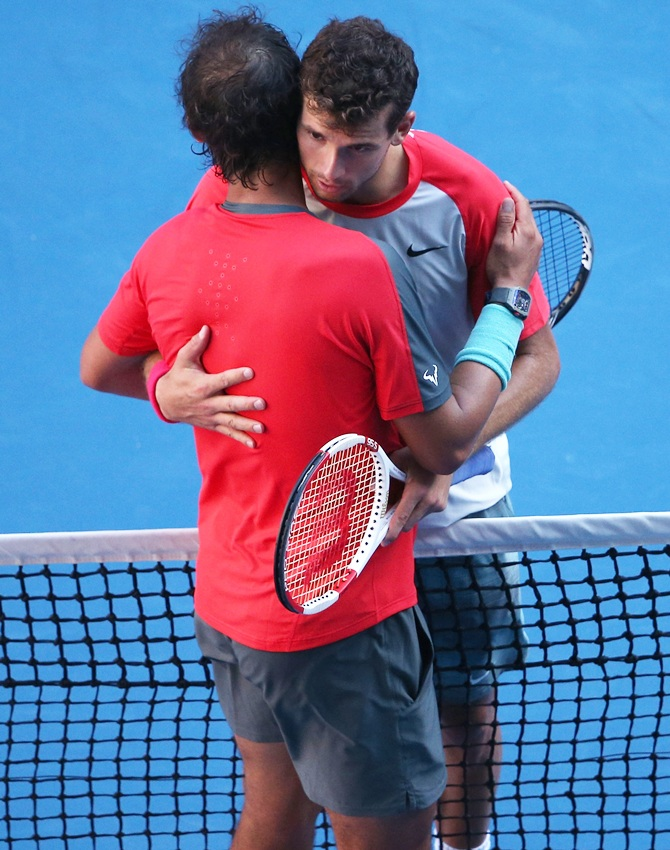 Grigor Dimitrov of Bulgaria and Rafael Nadal of Spain hug