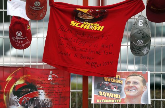 Caps, flags and a shirt marking the 45th birthday of seven-time former Formula One world champion Michael Schumacher