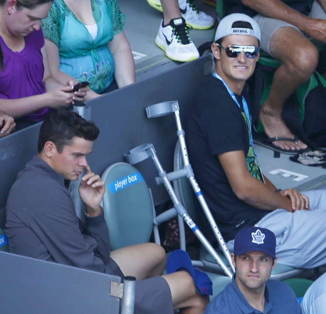 Bernard Tomic of Australia and Milos Raonic of Canada supports Eugenie Bouchard
