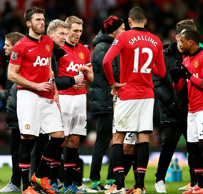 David Moyes the Manchester United manager speaks with his players