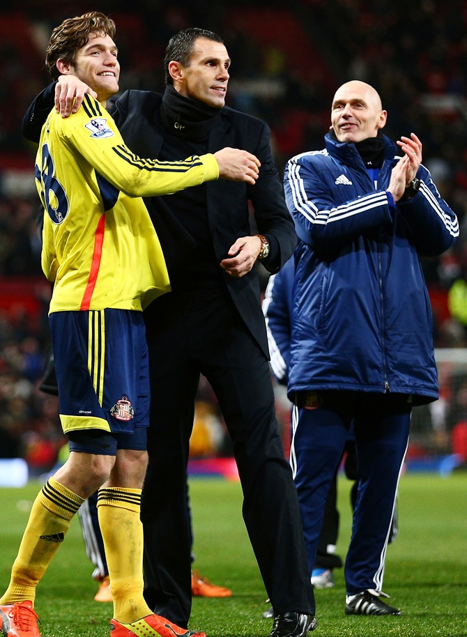 (From Left) Marcos Alonso of Sunderland and Gus Poyet the   Sunderland manager celebrate following their team's 2-1 victory