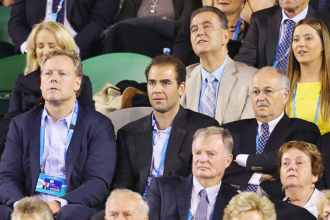 Former tennis player Pete Sampras watches Roger Federer and Rafael Nadal battle it out in the semi-final