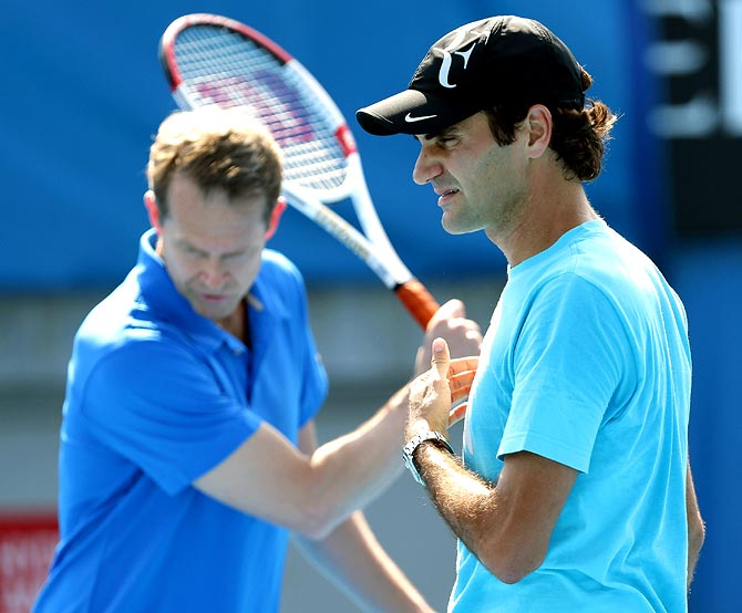 Roger Federer (right) with his coach Stefen Edberg during a training session
