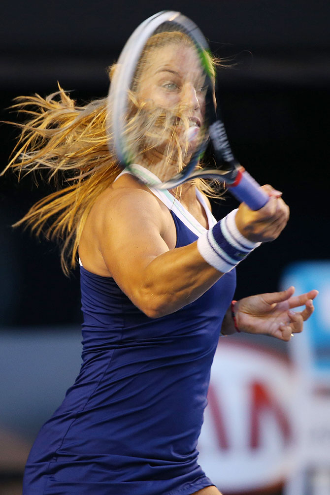 Dominika Cibulkova of Slovakia plays a forehand in her women's final match against Na Li of China