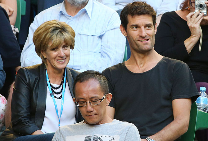 Former Formula 1 driver Mark Webber and his partner Ann Neal watch the women's final match between Na Li of China and Dominika Cibulkova of Slovakia