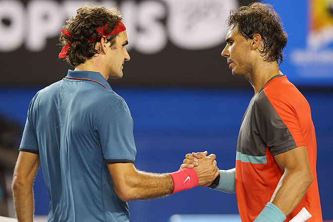 Rafael Nadal of Spain shakes hands with Roger Federer of Switzerland after Nadal won their semi-final match on Friday