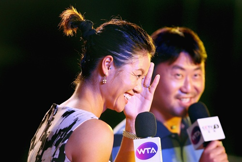 Li Na (left) and her husband Jiang Shan