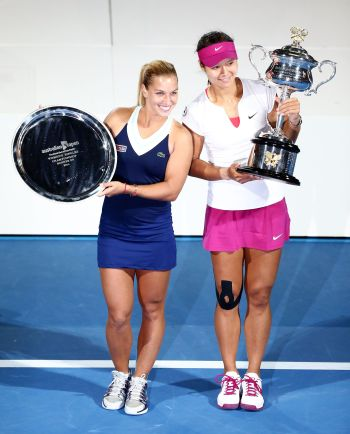 Dominika Cibulkova of Slovakia holds the runner up trophy after losing to Na Li of China