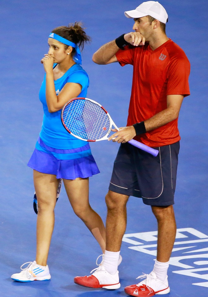 Sania Mirza of India and Horia Tecau of Romania talk