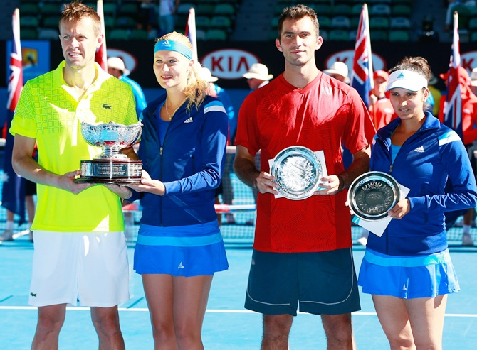 Kristina Mladenovic of France and Daniel Nestor of   Canada pose with the winners trophy, and Sania Mirza of   India and Horia Tecau of Romania pose with the runner up trophy