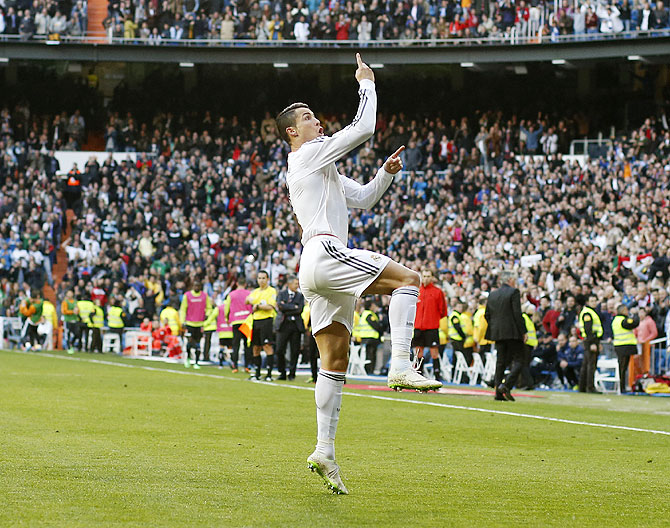 Real Madrid's Cristiano Ronaldo celebrates his goal during their La Liga match against Granada at the Santiago Bernabeu stadium in Madrid on Saturday