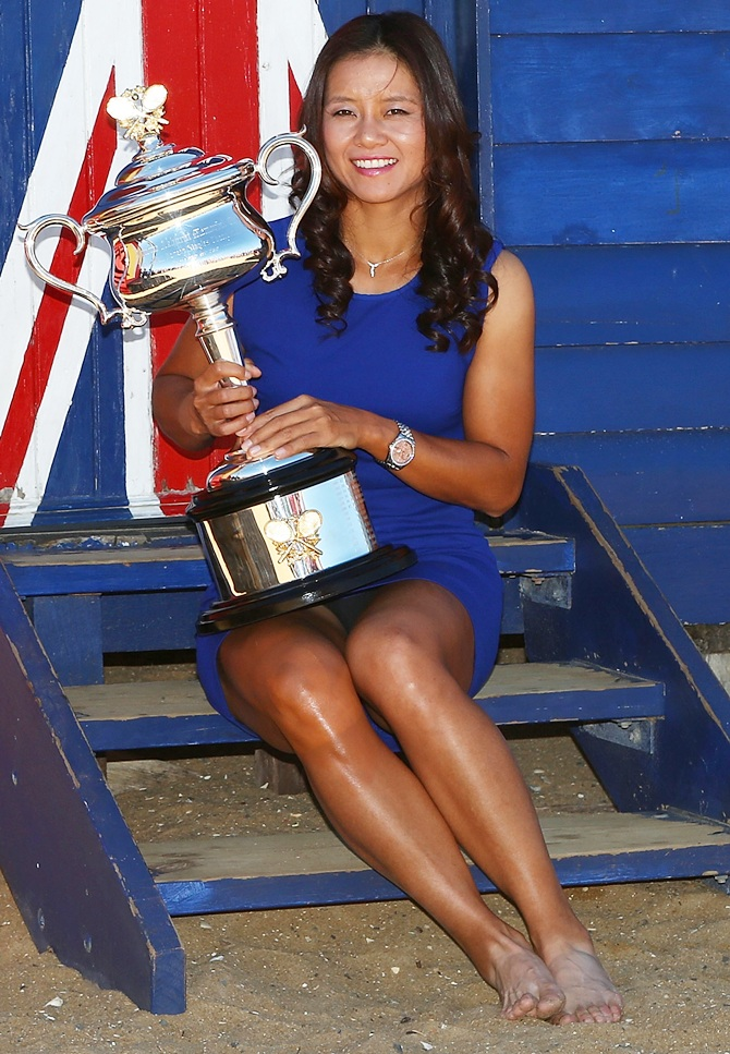 Li Na of China poses with the Daphne Akhurst Memorial Cup at Brighton Beach, after winning the 2014 Australian Open