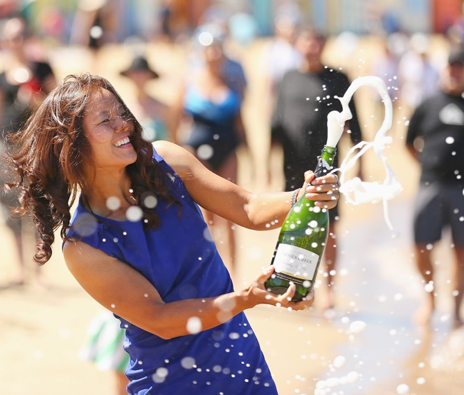 Li Na of China sprays champagne during a photocall at Brighton Beach after winning the 2014 Australian Open