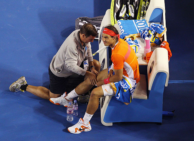 Rafael Nadal of Spain recieves medical attention between games in his quarterfinal match against Andy Murray of Great Britain during 2010 Australian Open