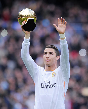 Cristiano Ronaldo of Real Madrid CF holds the Ballon d'Or 2013 award prior to he start of the La Liga match between Real Madrid CF and Granada CF at Santiago Bernabeu stadium on Saturday