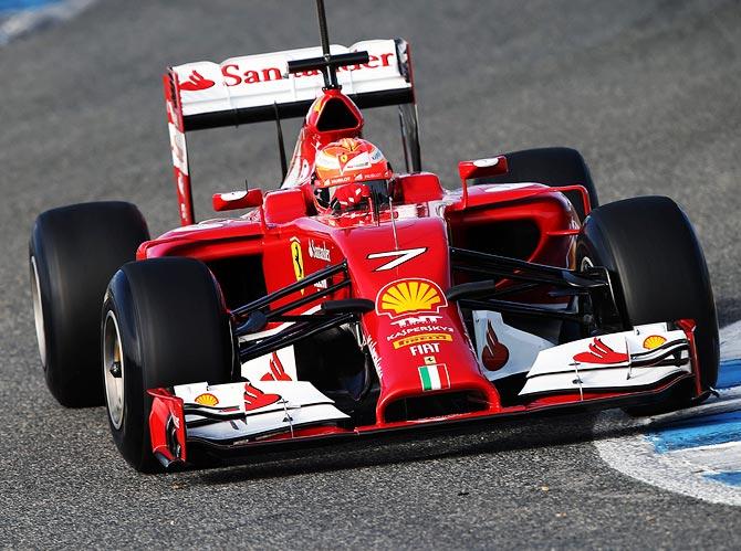 Kimi Raikkonen drives the new Ferrari's new car F14T