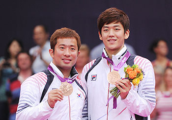 Lee Yong-dae (left) and Jae Sung Chung of Korea (L) during the 2012 London Olympics medal ceremony