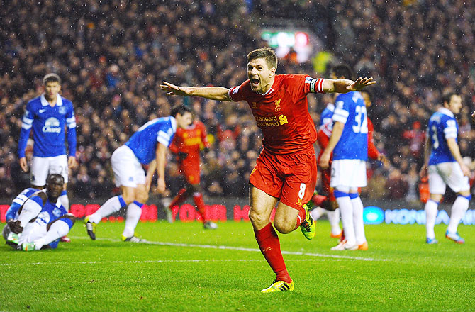 Steven Gerrard of Liverpool celebrates after scoring the opening goal against Everton
