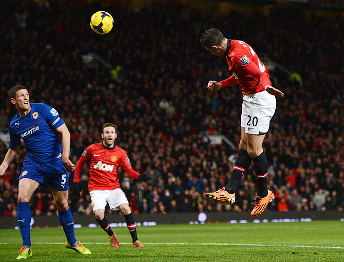 Robin van Persie of Manchester United scores the opening goal against Cardiff City during their English Premier League match at Old Trafford in Manchester on Tuesday
